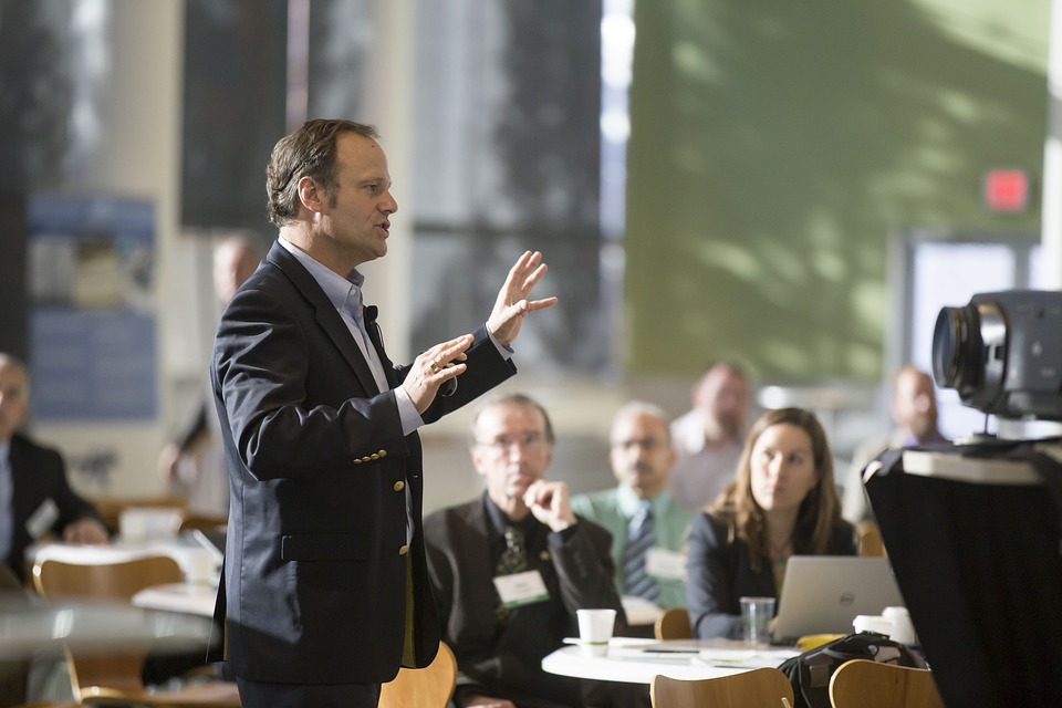 Man talking to audience in conference